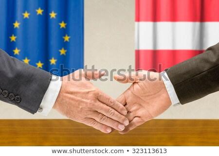 Representatives of the EU and Austria shake hands Stock photo © Zerbor