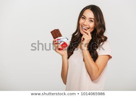 Vonzó fiatal nő tart csokoládé szelet portré fehér Stock fotó © deandrobot
