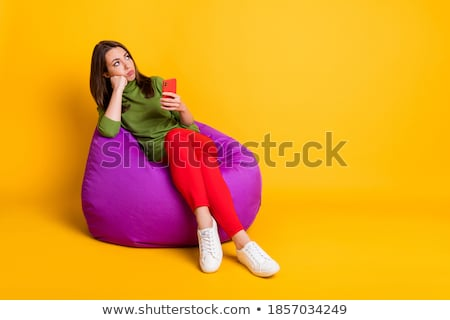 Young bored upset woman sitting on chair Stock photo © artfotodima