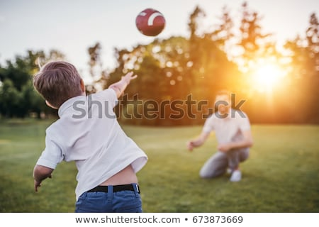 Kid Playing Football With His Father Stock photo © AndreyPopov