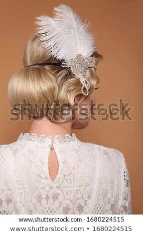 Portrait of a young blond model with fabulous coiffure Stock photo © konradbak