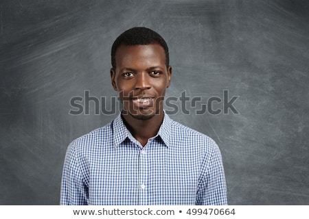 улыбаясь · молодые · темно · человека · фото · сидят - Сток-фото © deandrobot
