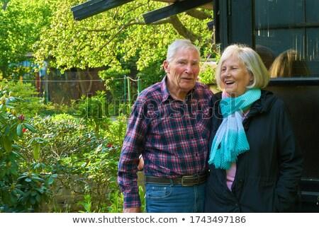 Retrato sorridente senior mulher em pé cabana Foto stock © wavebreak_media