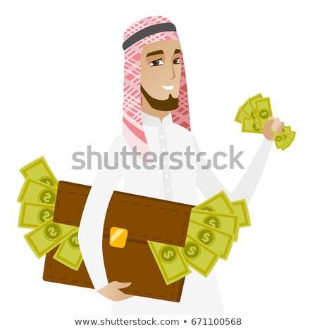 Muslim businessman with briefcase full of money. Stock photo © RAStudio