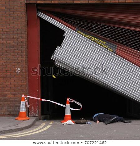 Woman lying underneath broken shutter Stock photo © IS2