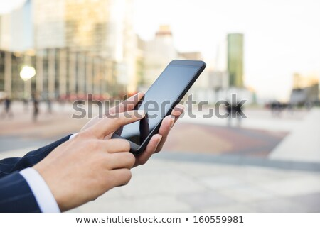 businesswoman holding mobile phone and using digital screen stock photo © wavebreak_media