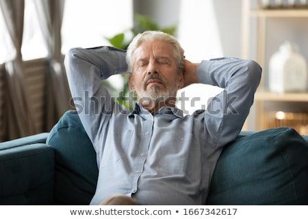 Senior Adult man asleep on sofa Stock photo © IS2