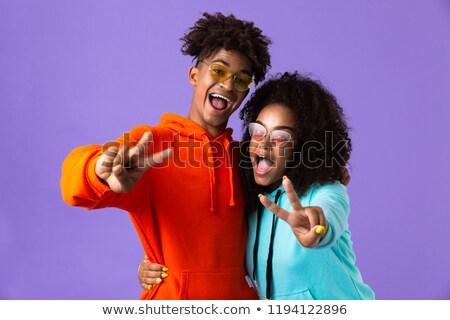 Boldog fiatal aranyos afrikai pár pózol Stock fotó © deandrobot