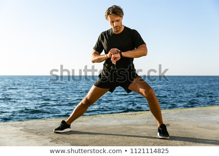 man with fitness tracker training outdoors Stock photo © dolgachov
