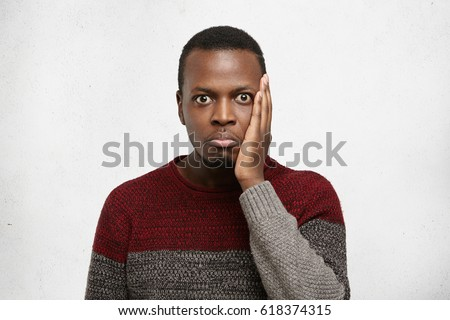 Portrait a confused man dressed in sweater Stock photo © deandrobot