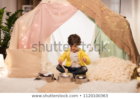 boy with pots playing music in kids tent at home Stock photo © dolgachov