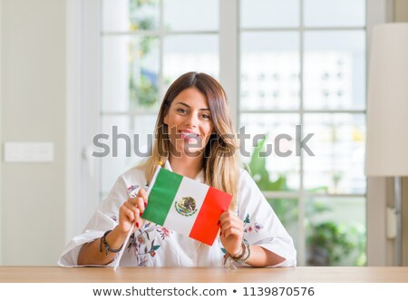 Girl holding flag of Mexico Stock photo © colematt