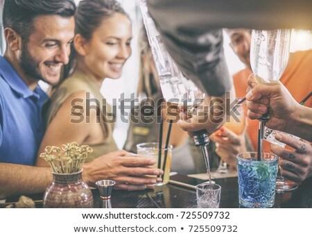 two woman having cocktail party in bar stock photo © kzenon
