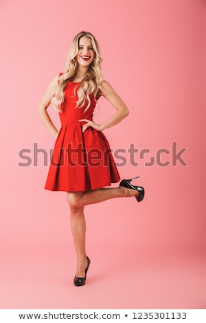 Young beautiful girl in bordo clothes posing at camera. Stock photo © studiolucky