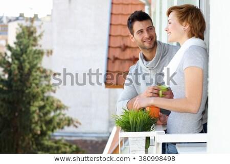 Fiatalember kávé erkély közelkép fiatal kaukázusi Stock fotó © nito