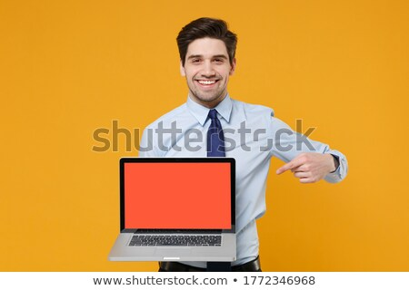 Smiling businessman pointing finger at blank notebook. Stock photo © lichtmeister