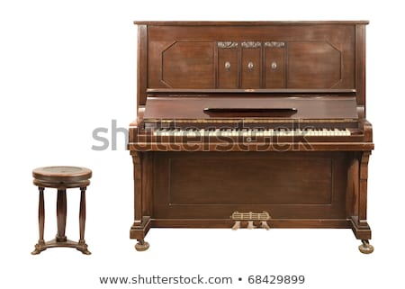 brown piano isolated on a white background stock photo © ozaiachin