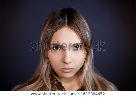 Young woman with haughty gaze Stock photo © photography33