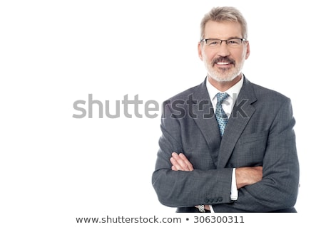 Smiling senior executive posing with folded arms stock photo © stockyimages