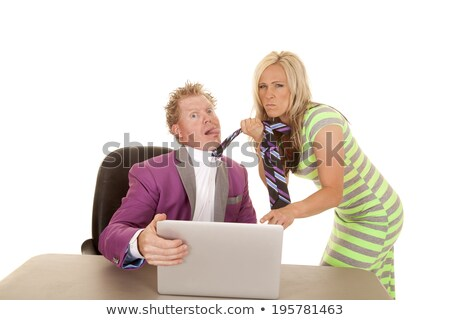Woman grabbing man from his tie Stock photo © stockyimages