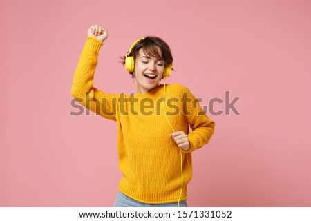 Young woman with headphones. stock photo © kyolshin