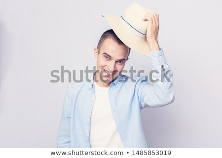 casual man takes off his hat stock photo © feedough
