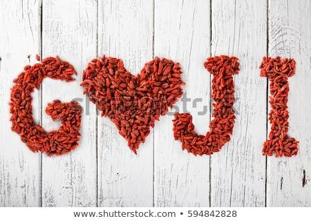 Goji berries heart shaped on white stock photo © Escander81