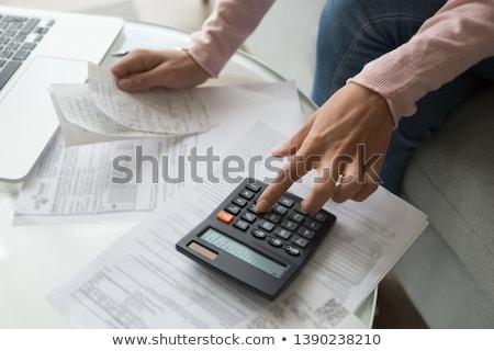 zakenvrouw · financiële · berekening · bureau - stockfoto © andreypopov