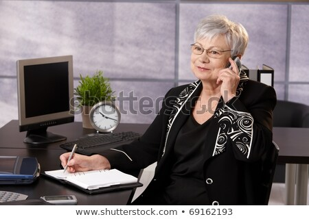 Mujer de negocios hablar teléfono escrito organizador Cafetería Foto stock © vlad_star