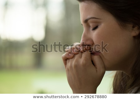 Sad woman praying Stock photo © ichiosea