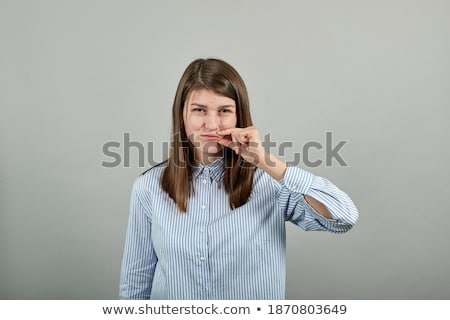beautiful young brunette woman showing to keep silence sign stock photo © nejron