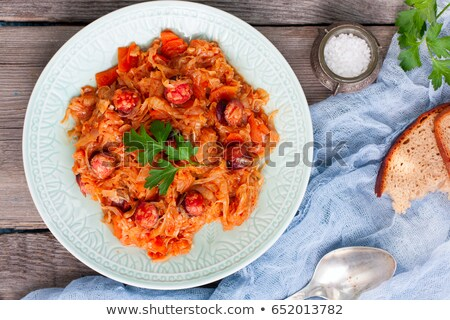Fried sausage with stewed cabbage Stock photo © Makse