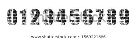 Aantal muur verweerde straat teken object Stockfoto © Digifoodstock