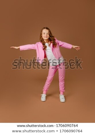 girl in pink clothes does gymnastic exercise stock photo © paha_l