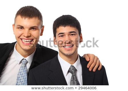 young businessman embraces another for shoulder Stock photo © Paha_L