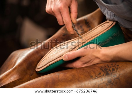 Hands making shoes Stock photo © deyangeorgiev