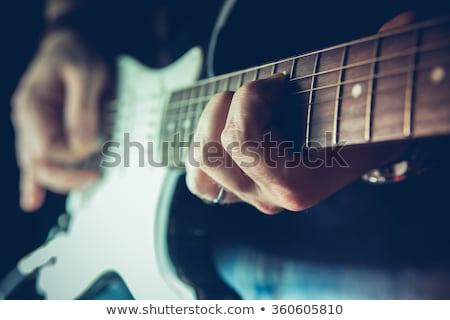 Pormenor dedos mão guitarrista corda mãos Foto stock © meinzahn