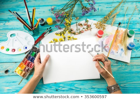 Stock photo: Paper, watercolors and paint brush on wooden background