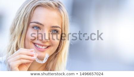 Boldog mosolyog fiatal nő fogszabályozó divat portré Stock fotó © dolgachov