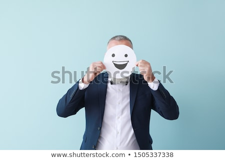 businessman hiding face behind paper Stock photo © IS2