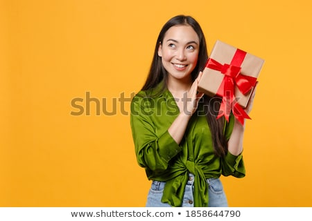 Portrait of a pensive young woman holding present box Stock photo © deandrobot