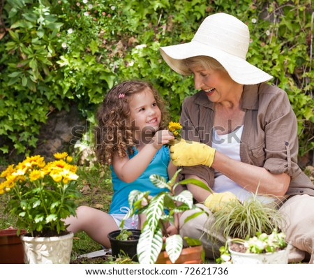 grandmother and girl with flowers at summer garden stock photo © dolgachov