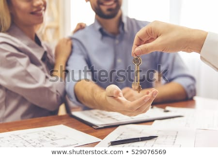 Stock photo: woman realtor with key at office