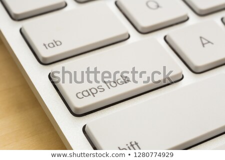 Close key lock and keyboard on wooden table. Stock photo © vinnstock