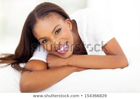 nyugodt · nő · telefonál · néz · hálószoba · arc · haj - stock fotó © lopolo