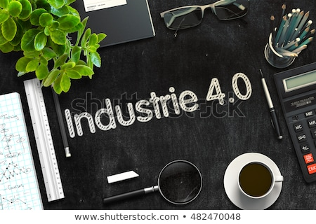 Industry 4.0 Handwritten on Black Chalkboard. 3D Rendering. Stock photo © tashatuvango