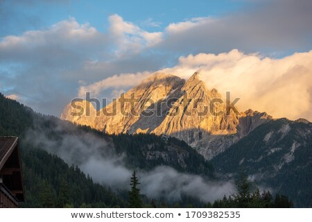 Sassolungo mountain in clouds Stock photo © frimufilms