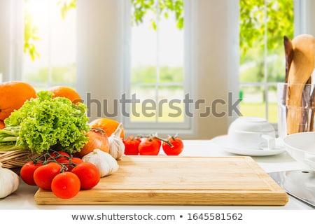 Konyhapult zöldségek arc nők boldog otthon Stock fotó © Lopolo