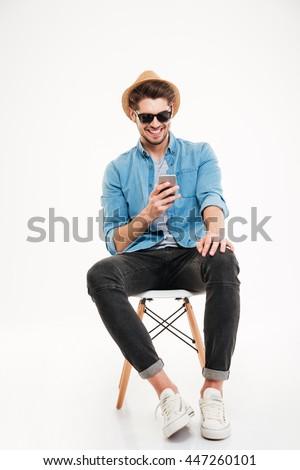 młody · człowiek · wzywając · telefonu · komórkowego · mówić · domu · twarz - zdjęcia stock © dolgachov