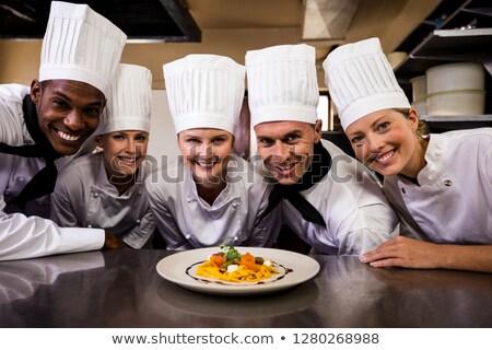 Grupo chefs olhando preparado macarrão cozinha Foto stock © wavebreak_media